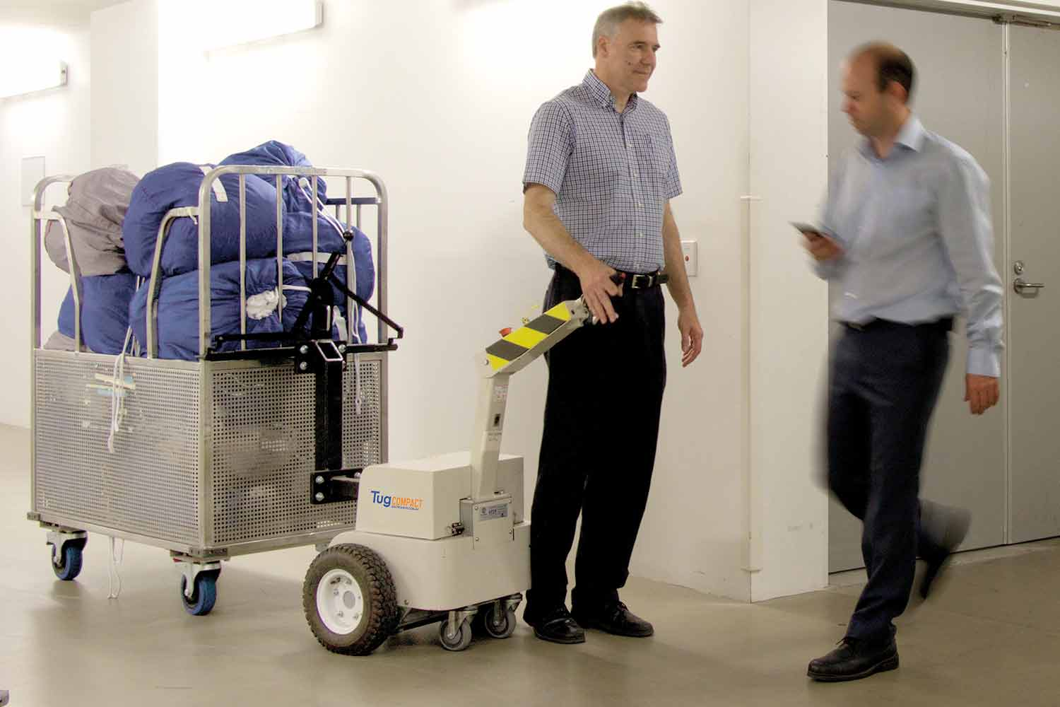 Electrodrive's Tug Compact Linen Mover keeps the user in front of the load